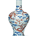 An <b>iron</b>-<b>red</b> <b>decorated</b> blue and white 'four-dragon' vase, Yongzheng six-character mark and of the period (1723-1735)