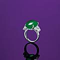 An <b>oval</b> <b>jadeite</b> <b>cabochon</b> and diamond ring
