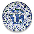 An Iznik blue and green pottery 'grape' dish, Turkey, <b>circa</b> <b>1565</b>