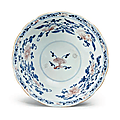 A blue and white, copper red and celadon-glazed shallow bowl,Qianlong six-character seal mark in underglaze blue and of the period (1736-1795)