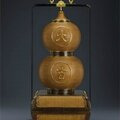 A very rare Imperial large lacquer-lined <b>bamboo</b>-weave three-tiered double-gourd box, Qing dynasty, 18th century