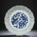 A superb <b>and</b> extremely rare early Ming blue <b>and</b> white '<b>Dragon</b> <b>and</b> <b>Phoenix</b>' brushwasher, Yongle period (1403-1424)