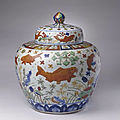 An important <b>and</b> rare large wucai fish jar, <b>Jiajing</b> <b>six</b>-<b>character</b> <b>mark</b> <b>and</b> <b>of</b> <b>the</b> <b>period</b> (1522-1566)