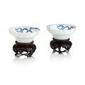 A pair of blue and white ogee-shaped 'dragon' bowls. Bearing a Chenghua six character mark, but Kangxi. Photo Bonhams.