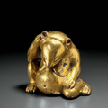 A superb gilt-bronze figure <b>of</b> a seated bear, China, Western Han dynasty (206 BC-AD 8)