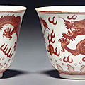 A pair of small iron-red-decorated 'Dragon' <b>wine</b> <b>cups</b>, Tongzhi six-character marks and of the period (1862-1874)
