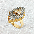 A 5.25 carats Fancy Brown-Yellow marquise-cut diamond and diamond ring, by <b>Andrew</b> <b>Grima</b>