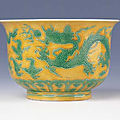 A rare yellow-ground '<b>Green</b> <b>dragon</b>' deep bowl, Encircled Zhengde four-character mark and of the period (1506-1521)