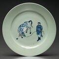 An unusual underglaze-blue and copper-red-decorated celadon-ground dish, Kangxi period, <b>circa</b> <b>1675</b>-1700
