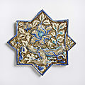 A kashan lustre painted star-shaped tile with a simurgh, 14th century