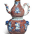An <b>underglaze</b>-<b>blue</b> <b>and</b> <b>copper</b>-<b>red</b> 'Immortals' wine ewer, warmer <b>and</b> a cover, Qing dynasty, Qianlong period (1736-1795)
