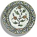 An iznik polychrome pottery dish with floral stem, turkey, 17th century