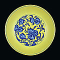 A lemon-<b>yellow</b>-<b>ground</b> <b>underglaze</b>-<b>blue</b> 'nine peaches' dish, seal mark and period of Qianlong (1736-1795)