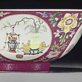 A <b>famille</b> <b>rose</b> ruby-ground 'medallion' bowl, Qianlong seal mark in underglaze blue and of the period (1736-1795)