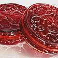 A rare pair of transparent red glass 'chilong' boxes and covers, Qing dynasty, 18th century