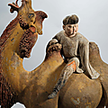 A finely painted pottery figure of a <b>Bactrian</b> <b>camel</b> and rider, Tang dynasty (618-907)