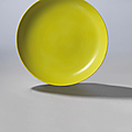 A lemon-yellow enamelled dish, yongzheng six-character mark in underglaze blue within a double circle and of the period