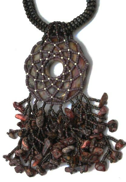 netted donut pendant overflowing with embellishments