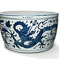 A very rare large blue and white 'Dragon and Lotus' fish basin, Jiajing six-character mark in underglaze blue in a line and of the period (1522-1566)