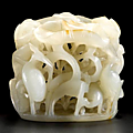 A carved and reticulated nephrite <b>hat</b> <b>finial</b>. Ming dynasty