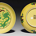 A pair of green and <b>aubergine</b>-<b>glazed</b> yellow-ground dishes, Qianlong seal marks in <b>aubergine</b> and of the period (1736-1795)