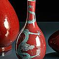 A <b>copper</b>-<b>red</b> <b>glazed</b> porcelain bottle vase with a green and blue enamel dragon, 19th century