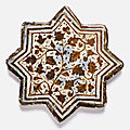 An ilkhanid lustre painted star-shaped tile, 14th century