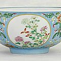 A famille rose blue-ground <b>medallion</b> <b>bowl</b>, Daoguang six-character seal mark in underglaze-blue and of the period (1821-1850)