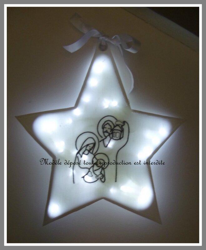 vellleuse étoile tissu blanc broderie Ste famille grise