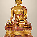 A highly important and monumental imperial gilt-lacquered wood figure of the Medicine <b>Buddha</b>, Qing dynasty, 18th century