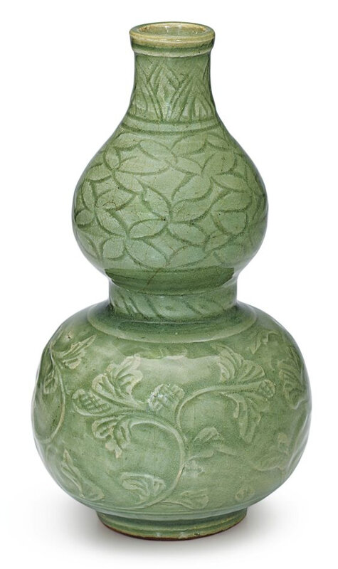 A Longquan celadon 'peony' double gourd vase, Ming dynasty, 16th – 17th century