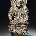 A dark grey limestone figure of <b>Amitabha</b> <b>Buddha</b>, inscribed Jinglong third year (709), and of the period