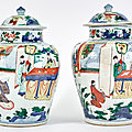 A Pair of Chinese <b>Wucai</b> Porcelain Jars and Covers, Transitional Period