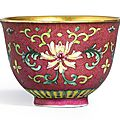 A small famille-rose ruby-ground 'lotus' sgraffiato wine cup, seal mark and period of Qianlong (1736-1795)