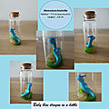 Baby blue dragon in a bottle