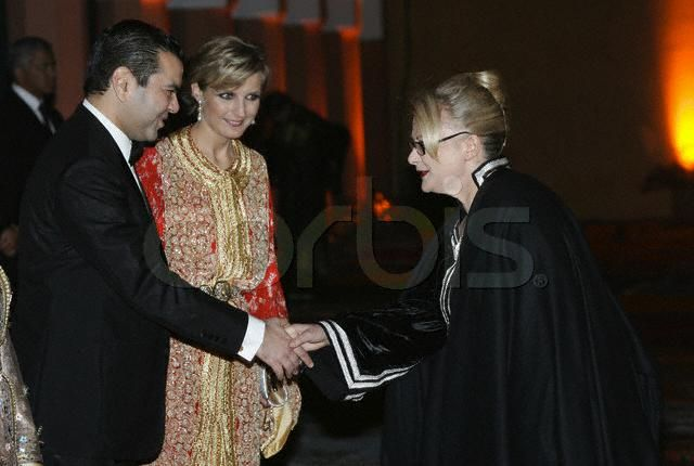 HRH Prince Moulay Rachid, accompanied by Melita Toscan du Plantier, shakes hands with actress Josiane Balasko during the Royal gala dinner at the 2004 Marrakech Film Festival.