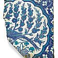 An Iznik cobalt blue and white pottery tile fragment with a peacock, Turkey, circa <b>1540</b>-50