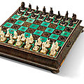 A silver-inlaid, tortoiseshell-veneered, carved ivory and ebonised wood chess set, <b>Augsburg</b>, circa 1705-1709