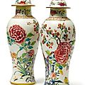 A pair of chinese export porcelain famille-rose baluster vases and covers, qing dynasty, circa 1750