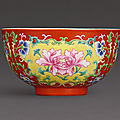A finely enamelled coral-ground famille-rose bowl, Seal <b>mark</b> <b>and</b> <b>period</b> <b>of</b> <b>Qianlong</b> (1736-1795)