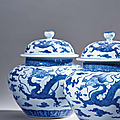 A rare pair of blue <b>and</b> white 'dragon' jars <b>and</b> covers, Qing dynasty, 18th century