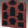 A rare carved red lacquer hanging <b>display</b> cabinet, Qianlong period (1736-1795)