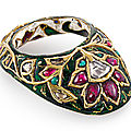 A Mughal <b>gem</b>-<b>set</b> <b>and</b> <b>enamelled</b> <b>gold</b> archer's ring, North India, circa 17th century