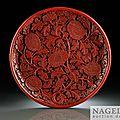 A very rare, large circular, carved cinnabar lacquer (tihong) dish, <b>Yongle</b> <b>incised</b> <b>six</b> <b>character</b> <b>mark</b> <b>and</b> <b>of</b> <b>the</b> <b>period</b>