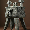An extremely rare and important <b>archaic</b> <b>bronze</b> <b>wine</b> <b>vessel</b> and cover, (fangjia), Late Shang Dynasty, 13th - 11th century BC