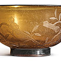 A rare engraved translucent amber glass 'floral' bowl, <b>Qianlong</b> <b>mark</b> <b>and</b> <b>period</b> (<b>1735</b>-<b>1796</b>)
