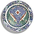 An iznik polychrome pottery dish with scale design, turkey, circa 1575