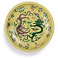 A rare <b>biscuit</b>-<b>enamelled</b> sancai 'Dragon' dish, Mark and period of Kangxi (1662-1722)