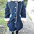 Un manteau chaud pour l'hiver: emmitouflé!