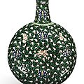 A fine and rare famille-noire 'floral scroll' moonflask, Qing dynasty, Yongzheng period